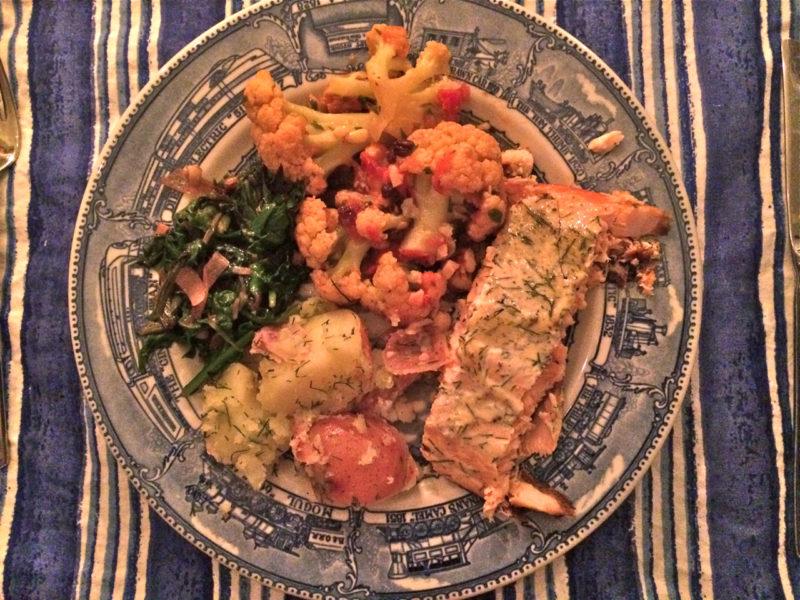 Salmon and potatoes, sautéed greens, and roasted cauliflower