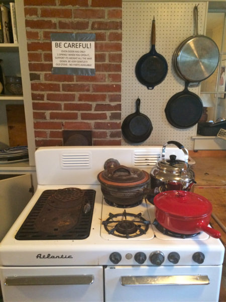 """Vintage kitchen, with a """"don't break the stove"""" sign"""