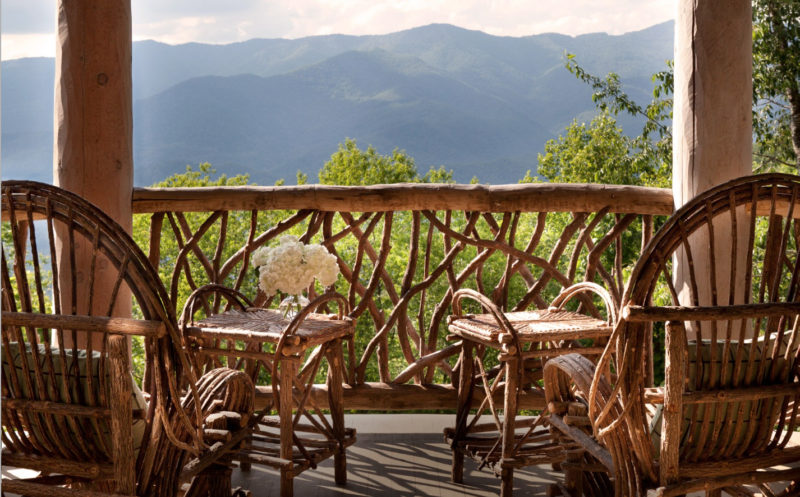 A gracious, hefty Adirondack balcony by Historical Concepts
