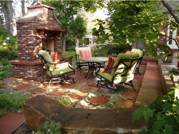 "Outdoor fire, terra cotta tiles with moss between, comfy chairs, a tree canopy—fabulous! Photo: TheMinimalist.com, ""100 Patio Design Ideas"""
