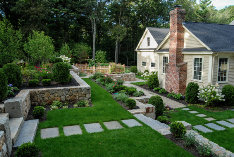 These terraced gardens hold a fenced vegetable garden. A Blade Of Grass Landscape Design, on Houzz.com