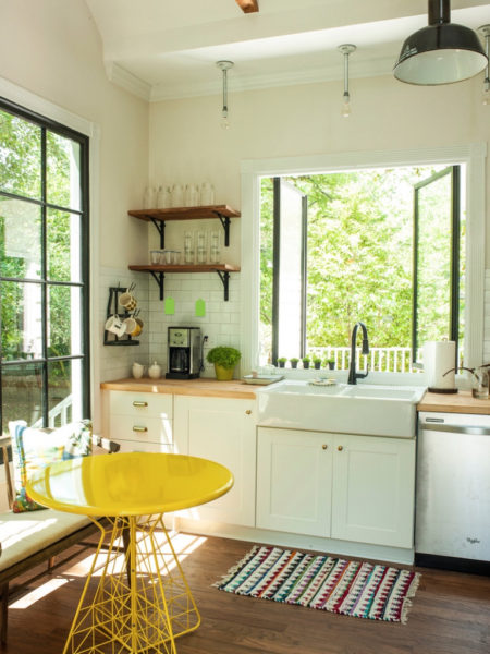 The window over the sink transforms the atmosphere of this corner kitchen. The Graham Residence, Houzz.com.