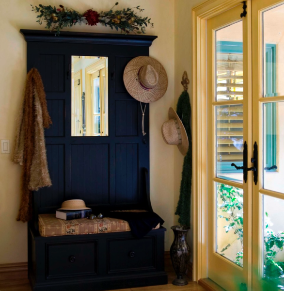 There's a view of the doorstep from the entry hall and adjacent room. The coat-rack/bench combo works in this small space. Peg Berens Interior Design on Houzz.com. Photo: Robert Naik