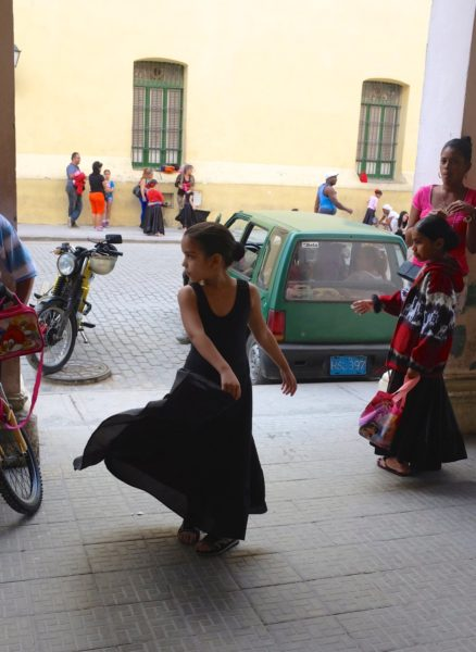A girl practices outside the studio before her class.