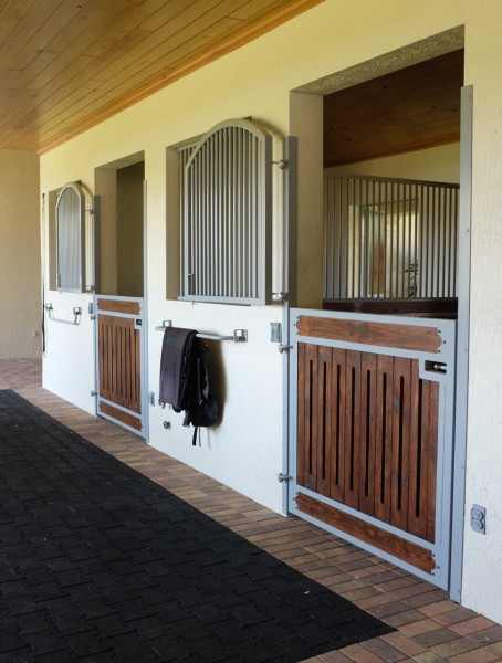 Custom powder-coated stalls by Lucas Equine Equipment
