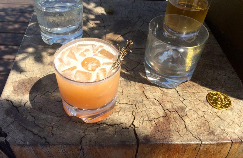 Cocktail with sage garnish